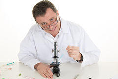 Chemist studying new substance in scientific lab Stock Image