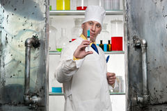 Chemist with syringe Royalty Free Stock Photos