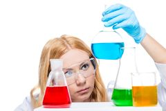 Chemist with test tubes on the table does analysis Stock Photos