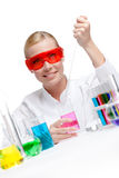 Chemist tests liquid in beaker Royalty Free Stock Image