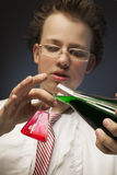 Chemist with two flasks Stock Photos