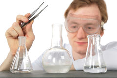 Chemist With Tweezers And Three Flasks Royalty Free Stock Image