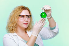 Chemist woman with chemical glassware flask royalty free stock photo
