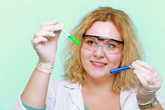 Chemist woman with chemical glassware tubes Royalty Free Stock Photo