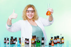 Chemist woman with glassware thumb up gesture isolated Stock Photography