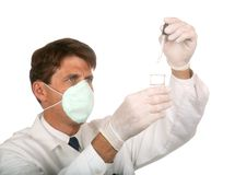 Chemist at work. Chemist adding drops to a mix royalty free stock photography