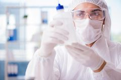 The chemist working in the lab. Chemist working in the lab Stock Photo
