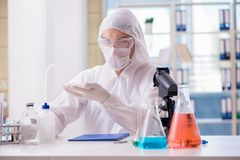 The chemist working in the lab. Chemist working in the lab Stock Photos