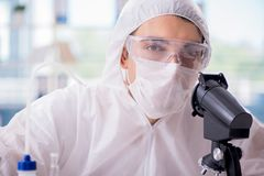 The chemist working in the laboratory with hazardous chemicals. Chemist working in the laboratory with hazardous chemicals Royalty Free Stock Photos