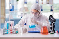 The chemist working in the laboratory with hazardous chemicals. Chemist working in the laboratory with hazardous chemicals Stock Photos