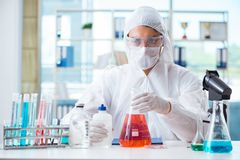 The chemist working in the laboratory with hazardous chemicals. Chemist working in the laboratory with hazardous chemicals Royalty Free Stock Image