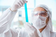 The chemist working in the laboratory with hazardous chemicals. Chemist working in the laboratory with hazardous chemicals Royalty Free Stock Photography