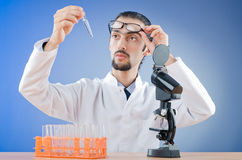 Chemist working with microscope Stock Images