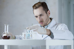 Chemist working with reagents in the laboratory Stock Photo