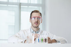 A chemist on the workplace in the lab Stock Image