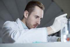A chemist works with chemicals Stock Photography