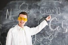 Chemist write a chemical formula on blackboard. Royalty Free Stock Photo