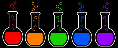 Chemistry. Flasks containing colorful chemical substances Royalty Free Stock Image