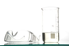 Chemistry beaker and glasses royalty free stock photos