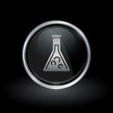 Chemistry beaker icon inside round silver and black emblem Royalty Free Stock Photo