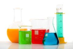 Chemistry bottles with liquid Royalty Free Stock Images