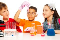 Chemistry class. Boys and girls learning chemistry and conduct experiments Royalty Free Stock Photo