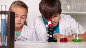 Chemistry class - kids experimenting and having fun stock video footage