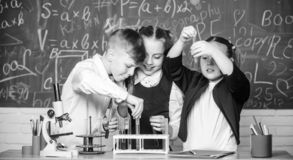Chemistry equipment. students doing experiments with microscope in lab. Happy children. Chemistry lesson. Chemistry stock image