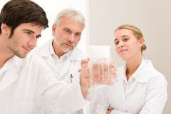 Chemistry experiment -  scientists in laboratory Stock Images