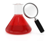 Chemistry flask and magnifier Stock Photography