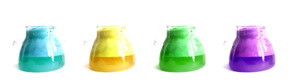 Chemistry. Four different colours beakers. Stock Images