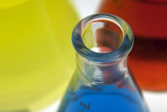 Chemistry is Fun!. Three different color chemicals (yellow, blue and red) in flasks Royalty Free Stock Image