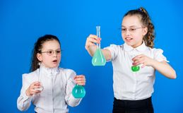 Chemistry fun. Basic knowledge. Knowledge day. Schoolgirl with chemical liquids. Education concept. Safety measures stock photo