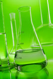 Chemistry glassware on green background Royalty Free Stock Image