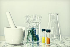 Chemistry. Glassware over periodic table Stock Photos