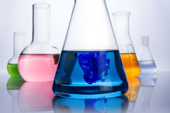 Chemistry laboratory equipment and blue drop Stock Photography