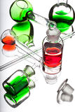 Chemistry laboratory glassware with colour liquids on white back Royalty Free Stock Image