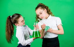 Chemistry lesson. Having fun with chemistry. Educative experiment. Chemistry fun. Knowledge day. Schoolgirl with. Colorful chemical liquids. Education concept stock images