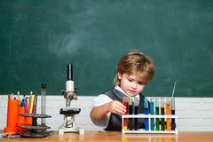 Chemistry lesson. School chemistry lessons. First grade. Little children at school lesson. Education. Back to school and. Happy time. Science. Science and royalty free stock photo