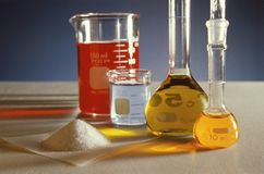 Chemistry scene. With beakers and powders Royalty Free Stock Photo