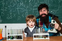 Chemistry the Science Classroom. School child. Dad son are concentrated on the problem. Lesson Plans - Middle School. Chemistry royalty free stock images