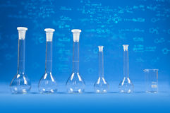 Chemistry science - flasks on blue background Royalty Free Stock Photo