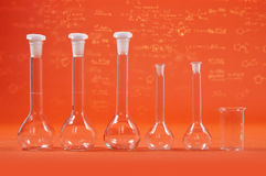 Chemistry science - flasks on orange background Royalty Free Stock Image