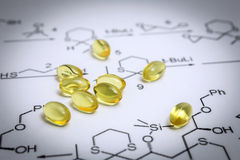 Chemistry science formula and oil capsules. Stock Photography