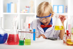 Chemistry. Shocked boy looking at smoke on the table in chemistry class Royalty Free Stock Photo