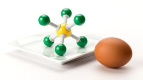 Sulfur molecule model and a brown round egg. Chemistry sulfur model with a representative egg stock photo