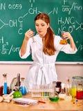 Chemistry teacher at classroom Stock Photos
