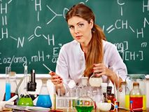 Chemistry teacher at classroom. Royalty Free Stock Image