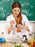Chemistry teacher at classroom. Royalty Free Stock Photo