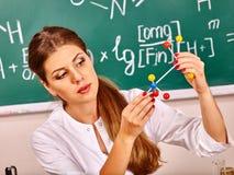 Chemistry teacher at classroom Royalty Free Stock Photos